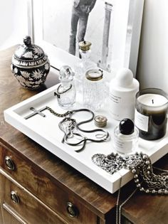 Trays can be your best friend when accessorizing - not only are they functional for containing clutter, they add dimension to a surface.