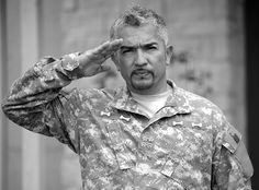 """Cesar Millan visits Fort Hood April 19 while filming an episode of """"The Dog Whisperer."""" Millan's ACU (Army Combat Uniform) was decorated with four paws, leading to him being referred as a """"four-paw general"""" for the day."""