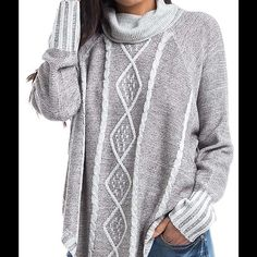Cute Gray Oversized Sweater Amazing sweater!! Cozy yet lightweight. Sides are cut higher and looks great with or without a camisole. Sizes range from medium to large, but they all fit a size 2-14 Boutique Sweaters