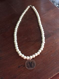 A personal favorite from my Etsy shop https://www.etsy.com/listing/234878237/pearl-necklace-with-monogrammed-acrylic