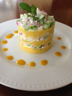 Peruvian appetizer causa rellena is a mashed potato cake layered with moist fillings.