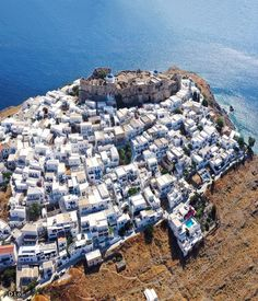 • The white houses embrace the castle tightly and together make the top of the hill glowing • * Astypalea island, Greece 🇬🇷