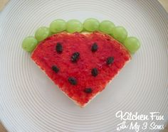 She made this cute watermelon lunch using 2 pieces of bread, peanut butter, strawberry jelly, raisins, and green grapes.    Just cut the corners off of the bread to make it look like a slice of watermelon. Spread peanut butter on the inside and the jelly on the outside. Put some raisins on the top to look like seeds. Cut the green grapes in half and stack them up on the top edge.    This is SO easy and a fun summer lunch!