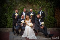Bride and groomsmen sit on bench with bouquets #Michiganwedding #Michiganwedding #Chicagowedding #MikeStaffProductions #wedding #reception #weddingphotography #weddingdj #weddingvideography #wedding #photos #wedding #pictures #ideas #planning #DJ #photography #bride #groom
