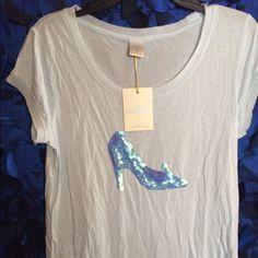 "Lauren Conrad Disney's Cinderella Tee Shirt Small Lauren Conrad Disney's Cinderella tee shirt. Light blue. Size small. Shoulders: 16"". Width: 16"". Length: 24.5"". NWT. Laure Conrad Tops Tees - Short Sleeve"