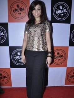 Amrita Puri: The dimpled actress paired her black palazzo pants with a metallic top and bangles. We like the combination!