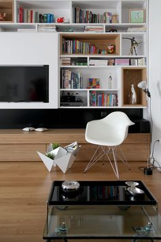 interior architecture, interior design, living room, bookcase, eames eiffel chair, tob design product (TSQUARE ARCHITECTS),  ingbert brunk  marble Traumsteine, alessi, vitra objects