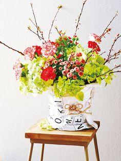 In stead of a vase, you can use a bucket with a tea towel wrapped around it.