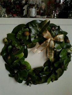 Magnolia leaves wreath w/ magnolia cones & acorns accented w/ gold glitter paint