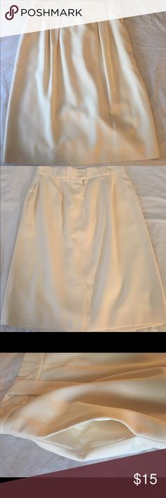 Cute and comfortable cream skirt. Great to wear to work with your favorite blouse. 100% Wool. Comfortable fit with pocketed on both sides. Skirts Midi