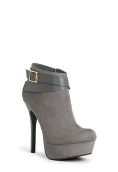 LONDON - You'll be the toast of the world's fashion capital—or anywhere really—in this sleek, sexy bootie. Features curved platform, slim stiletto and smooth buckle detail. Crafted from material that's equally luxe. Price $39.95