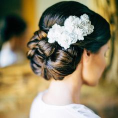 Wedding Updo - elaborate updo perfect for long, thick hair, but it also looks particularly great on dark hair when worn with a contrasting white accessory, like this lace clip. | DailyMakeover.com