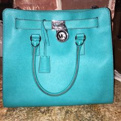 Brand New Michael Kors purse Beautiful turquoise color wth silver hardware still have the tag and not a single stain inside used one time. No trades. No low ballers. Any offers please use offer button!  Michael Kors Bags