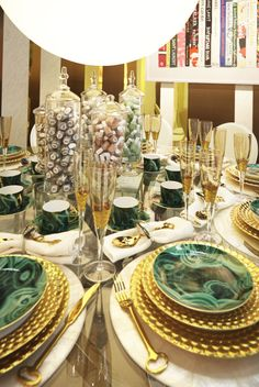 essie, designed by Robert Verdi, is ultra glam with malachite tableware and the newest Spring colors on display in the center #design #dining #tabletop