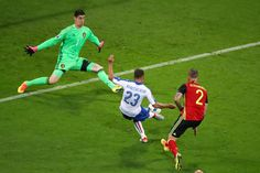 Emanuele #Giaccherini (C) of Italy scores his team's first goal past Thibaut Courtois (L) of Belgium during the UEFA EURO 2016 Group E match between Belgium and Italy at Stade des Lumieres on June 13, 2016 in Lyon, France.