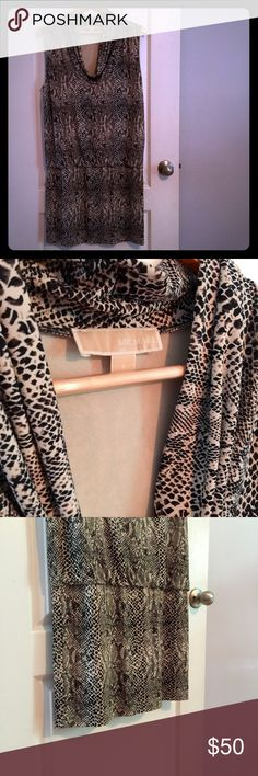 MICHAEL Michael Kors dress, Large. Gorgeous dress. Hugs curves well, and is great to throw a blazer over, or wear alone for a night out. Transition from office to evening in this subtle-glam animal print dress. Lots of stretch. Large. MICHAEL Michael Kors Dresses Midi