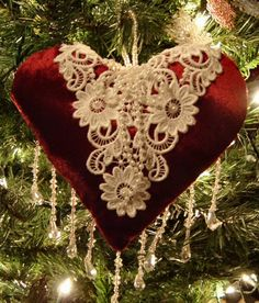 Lace piece embellishing heart as ornament