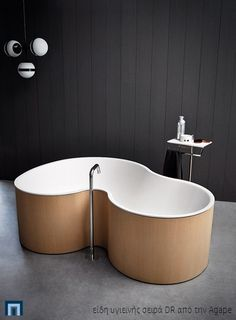 Two Person Tub - Designers Marcio Kogan and Mariana Ruzante of Brazilian  architecture firm Studio have collaborated with Italian bathroom  manufacturer Agape ... 3ee66a6d627