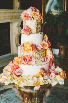 white and gold cake decorated with flowers // photo by Connection Photo // http://ruffledblog.com/glittery-outer-banks-wedding