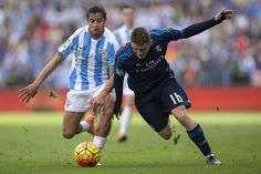 Mateo Kovacic of Real Madrid CF competes for the ball with Roberto Rosales of…