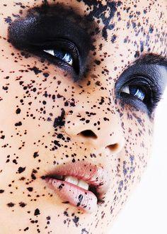 Black splatter makeup with intense black eyes