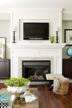 ( like the simple white fireplace but maybe a gray slate instead of white brick) Classic Living Room — Simply Inspired Design ~ Intentional Design § Intentional Living Tv Over Fireplace, Fireplace Wall, Living Room With Fireplace, Fireplace Surrounds, Fireplace Design, Home Living Room, Fireplace Ideas, Fireplace Molding, Mantel Ideas