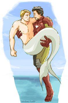 Tony Stark and Steve Rogers | Image: Tony Stark holding mermaid-Steve Rogers in a bridal carry ...