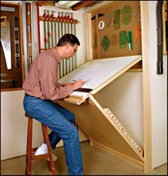 Shop Drafting Table -  Wall-mounted unit is sturdy, adjustable, and folds away flat