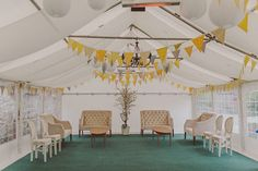 bunting and chandelier tent decor
