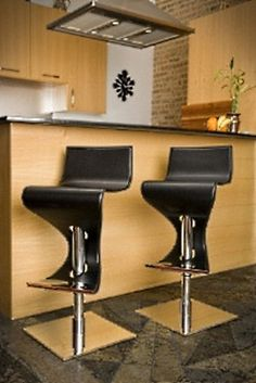 """Like a salsa dancer, the Vavoom Bar Stool adds instant movement and swing to any room. This curvaceous bar stool works great at an upscale bar, or in your own home. For maximum comfort, adjust the height of the chair from 29"""" to 39"""" with the hydraulic pump. Leatherette finish with polished chrome base, pole, and accents. Available in black and chocolate brown.    Dimensions: 16""""W X 16""""L X 39""""H (max)"""