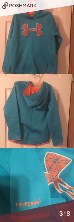 Under Armour hoodie girl's size Medium 10-12. Under Armour hoodie girl's size Medium 10-12. This is a great blue and coral Under Armour storm hoodie. Shows very minor wear. Is in great shape. Please view all pictures. Under Armour Shirts & Tops Sweatshirts & Hoodies