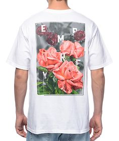 "Walk through your own Garden of Eden in the Rose Garden tee from Empyre. An all white, 100% cotton tee features an array of red roses on the back with Empyre's brand name spelled out in an ""X"" formation. A single red rose with the Empyre brand w"