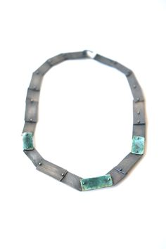 Part of Karen Gilbert's newest collection, comes this fully reversible necklace of oxidized sterling silver and enamel. Gallery Lulo.