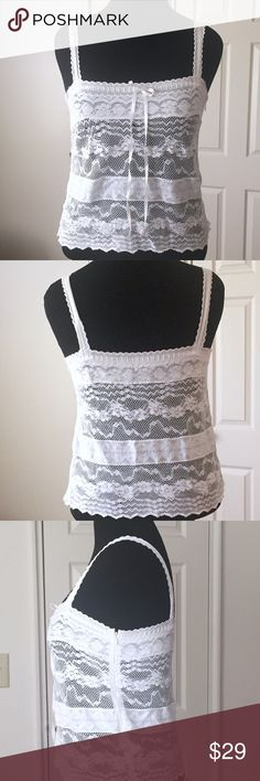 🆕 American Eagle White Lace Cami Top American Eagle white lace camisole top with ribbon intertwined around the top of the chest area which can be adjusted. Top has a side zipper as well. American Eagle Outfitters Tops Camisoles