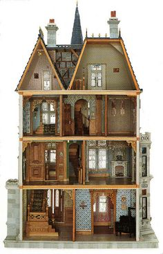 This scale model doll house as shown from the open rear, shows a typical Victorian era townhouse.