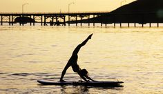 Watched people do this at wanderlust in Colorado this summer. It's so amazing and looks so peaceful. I'd love to try yoga on a paddle board sometime. :)