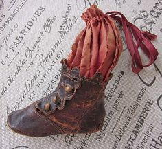 Antique purse from a baby shoe/wow this is so old it looks as if you touch the silk it will crumble in your hands!