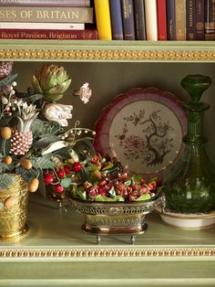 Dining room of Howard Slatkin.  In silver-gilt bowl is Torie & Howard organic candy. Porcelain flowers by Vladimir Kanevsky.
