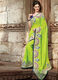 This Delightful Diva Accoutre Features Unique Styling And Unusual Material.  Add Grace And Charm On Your Appearance In This Attractive Parrot Green Faux Georgette Saree.  The Bead,Multi,Patch Work,Resham,Stones,Velvet Patch Work Looks Chic And Perfect For Any Get Together.
