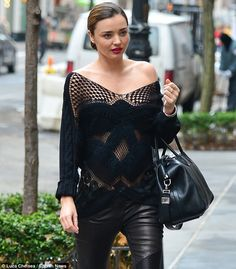 Miranda Kerr wears a crocheted (and knit as well, by the look of the sleeves) top strolling in NYC (December 2013)