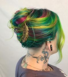 🌈Rainbow on the Go🌈 New rainbow hair and a cute quick messy updo makes adulting a little easier. Running around getting everything ever in life shipped out today, and still super obsessed with my new hairs! @livinlanitaloca really kicked some ass with this one. Now time to go do some afternoon hairs!!! Previous color removed with Joico color eraser. Colored with Arctic Fox and Kenra Neons. B3 added to all formulas. Accessory by @live.neekas