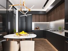 Clever lighting makes the kitchen look sharp and bright despite its dark cabinetry. The chandelier above the table is poised to impress.