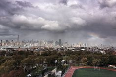Aftermath: A rainbow and looming clouds appear over the sky in New York's Manhattan today after the hurricane stormed the city