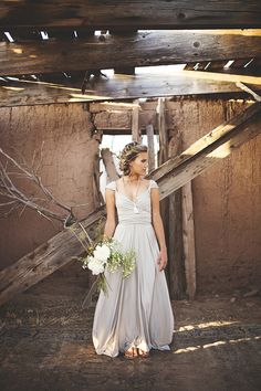 beautiful cap sleeve wedding dress, leather sandals and a tassle = perfectly relaxed bridal style