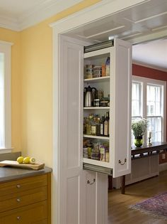 kitchen pantry out of the wall, brilliant use of an entryway wall