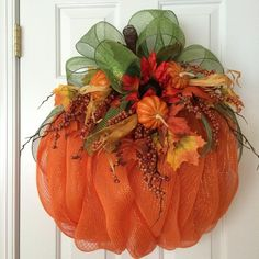 Celebrate all things fall with this beautiful pumpkin wreath that takes on a fiery glow in the sun. Pumpkin is made of weather resistant orange deco Pumpkin Mesh Wreaths, Deco Mesh Pumpkin, Autumn Wreaths, Holiday Wreaths, Wreath Fall, Thanksgiving Wreaths, Thanksgiving Decorations, Thanksgiving Prayer, Thanksgiving Appetizers