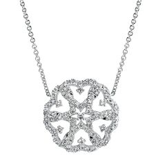 This elegant pendant from Gabriel & Co's Blossoming Heart Collection features a beautiful domed circular design set with genuine round brilliant diamonds. The openwork of the pendant gives this piece a timeless vintage feel. #hudsonpoolejewelers