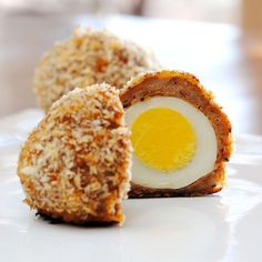 Scotch Eggs. YUM...I must try these. Eggs wrapped in sausage, dipped in egg, rolled in breadcrumbs and baked.