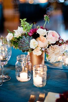 Rose gold painted tin can makes the perfect vase for these gorgeous garden roses, dahlias and succulents