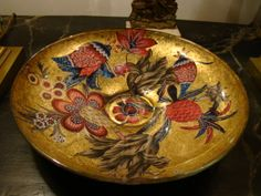 Jill Barnes-Dacey. Flat Platter with Asian/Indian cutouts on a gold leaf background